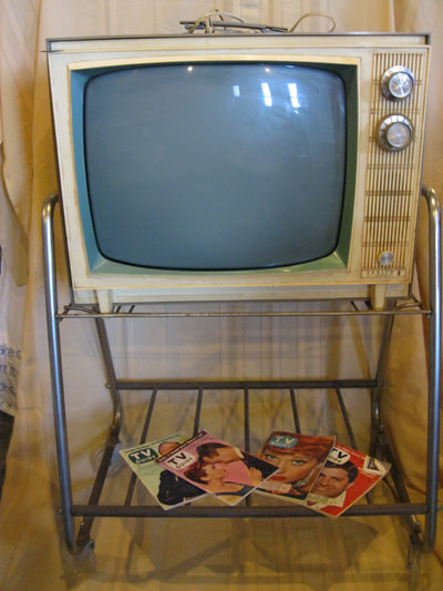 Early 1960s TV with cart, fully functional